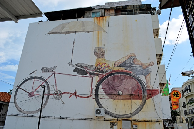 the-awaiting-trishaw-and-paddler-rickshaw-The-Street-Art-of-George-Town-Penang-Malaysia